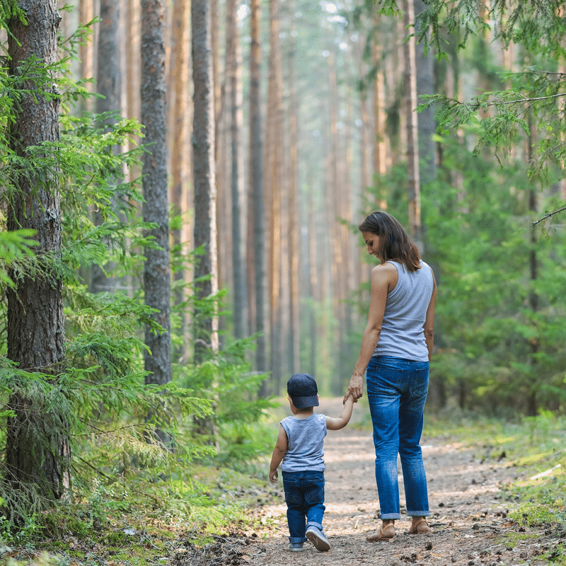 Mom and child in forest